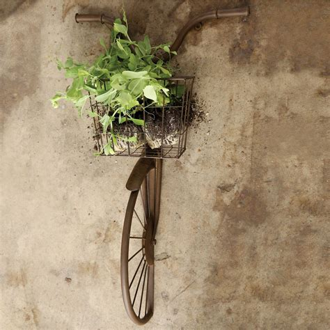 This is such an innovative and industrial way to hang them up! Hansen Bike with Basket Dimensional Metal Wall Sculpture | Baskets on wall, Basket wall decor ...