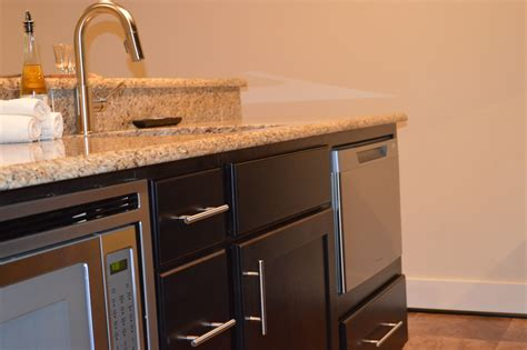 basement bar includes  island   microwave drawer  single drawer dishwasher