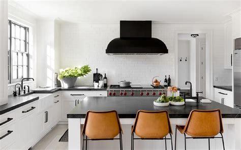 Black and White Kitchen with Orange Leather Barstools
