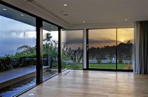 floor l in front of window how to decorate a room with floor to ceiling windows