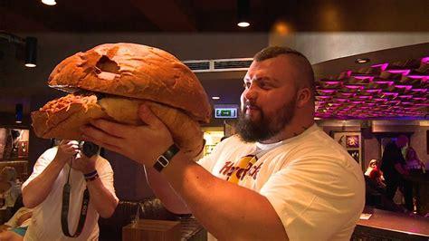 strongman eddie hall eats  giant kg hamburger