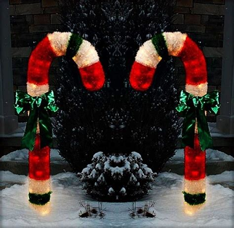 christmas  lighted tinsel candy canes outdoor yard