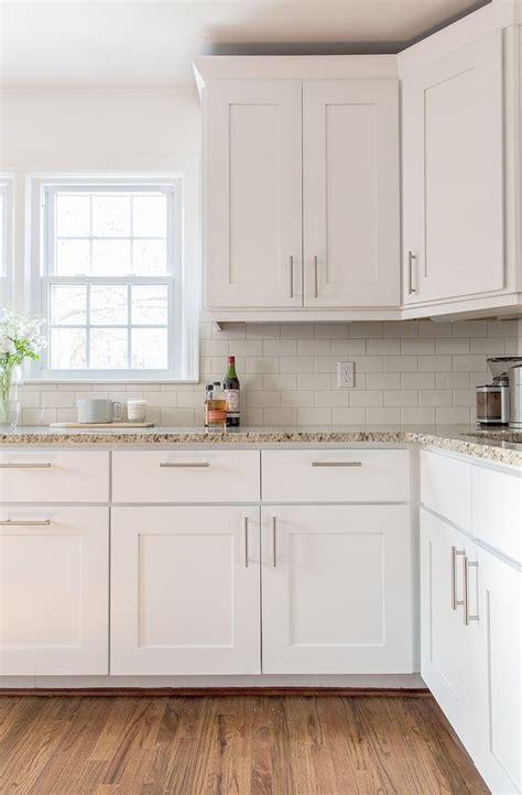 white cabinets  brushed nickel hardware unique