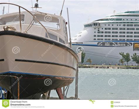 Small Boat On Larger Ship by Small Boat Large Ship Royalty Free Stock Images Image
