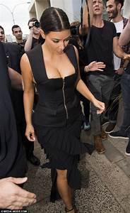 Kim Kardashian Displays Her Cleavage In Tight Black