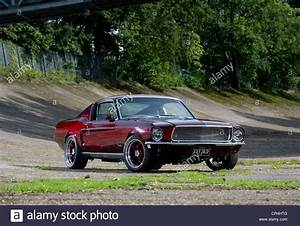 60s Ford Mustang fastback Eleanor style shot on Brooklands banking Stock Photo: 48659648 - Alamy