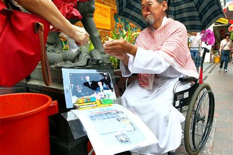 parrot man  selling tissue paper  temple