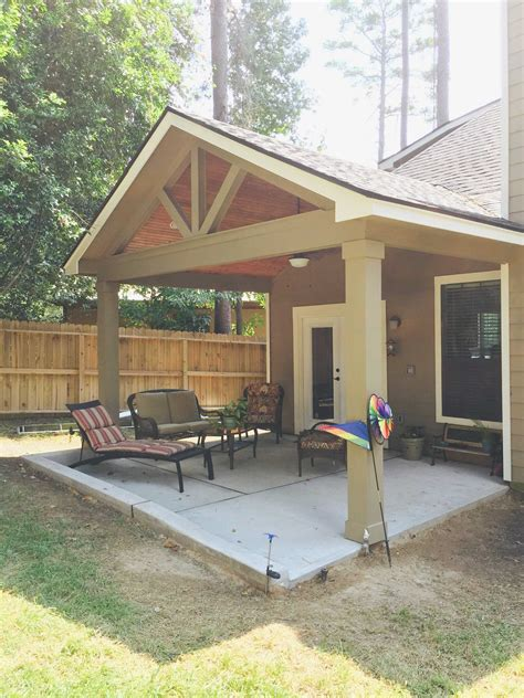 cost of building patio cost to build patio cover awesome gable roof patio cover with wood stained ceiling laxmid decor