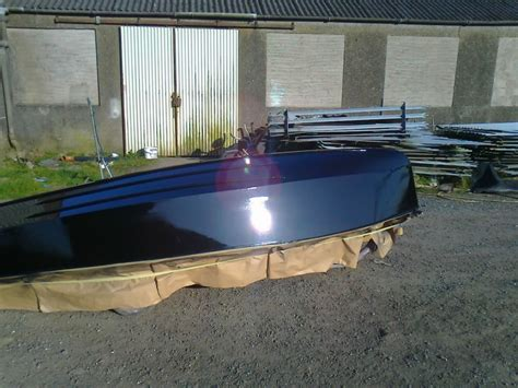 wooden gp racing dinghy painting  bare wood
