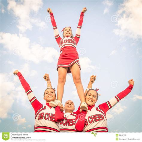 cheerleaders team  male coach stock image image