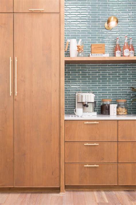 neutral midcentury modern kitchen  blue tile