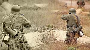 army outdoor soldiers shooting with a rifle and mortar in trench