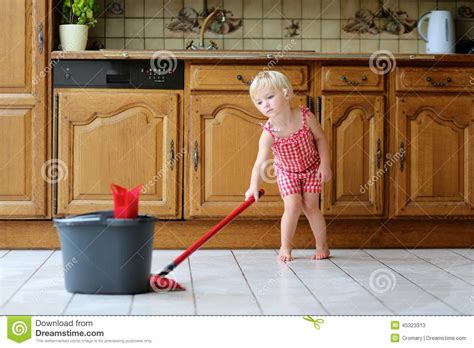best kitchen floor mop toddler mopping kitchen floor stock photo image 4522