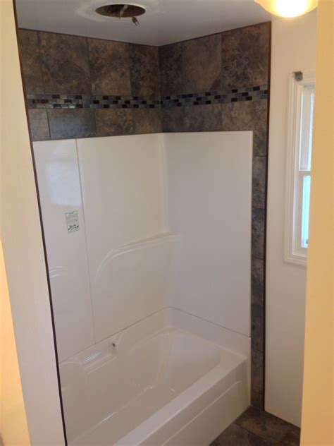 Decorating Ideas Tub Surround by Want To Dress Up That Empty Space Above Your Shower Or Tub