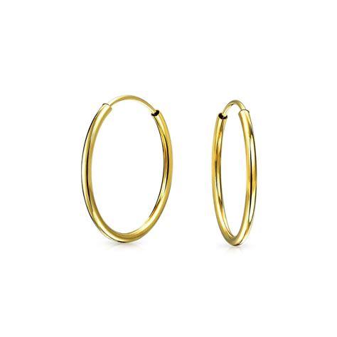 thin classic 14k yellow gold endless hoop earrings