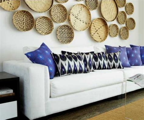 It can be used on a wall as part of your indoor decor or on a porch or patio. Modern Wall Decoration With Ethnic Wicker Plates, Bowls and Baskets