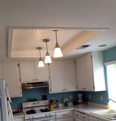 kitchen fluorescent light box remodel with wood beadboard