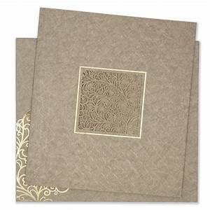 Indian Wedding Card In Light Brown Motifs And Laser Cut Design