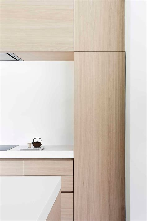 kitchen light wood cabinets light wood and white countertops create a neutral softness 5347