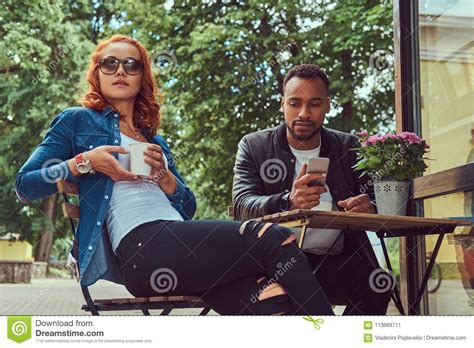 If you're tired of the same old trips to dunkin' donuts and starbucks, i have good news for you. A Couple Dating Drinking Coffee, Sitting Near The Coffee Shop. Outdoors On A Date. Stock Image ...