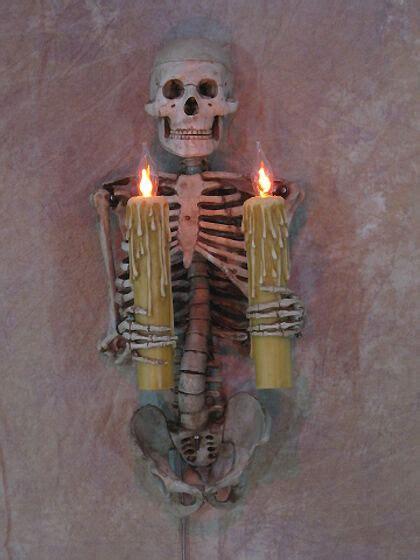 Skull Sconce - skeleton torso wall sconce holding candles skull