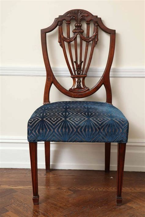 set of eight hepplewhite style mahogany dining chairs at