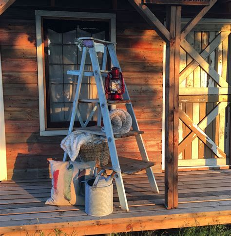Old wooden rustic ladder decorated for fall Fall front