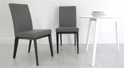 real leather dining chair with black wooden legs white
