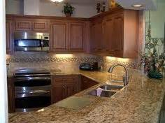 modern kitchen backsplash pictures brown also called alaska white granite countertops 7640