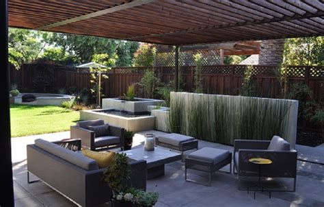 modern patio concrete with redwood and steel arbor