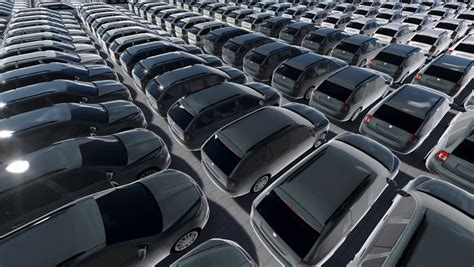 Many New Cars Parked And Distributed In Rows. Stock