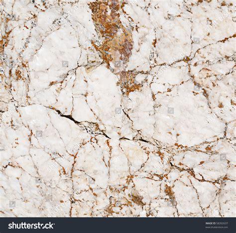 closeup white marble brown orange veins stock photo