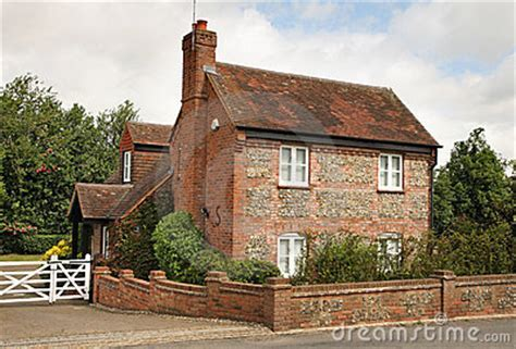 Traditional Brick And Flint English Cottage Royalty Free