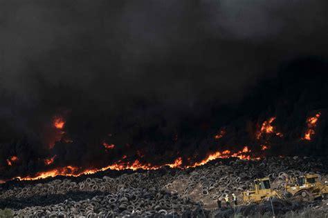 Topshot-spain-tire-fire-pollution-environment