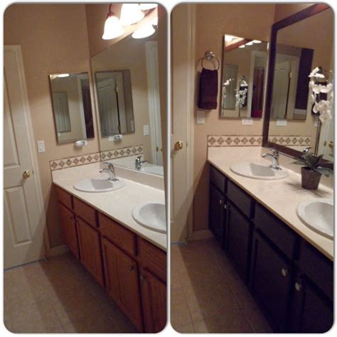 bathroom remodel framed mirror with mdf trim then spray painted with rustoleum glossy in