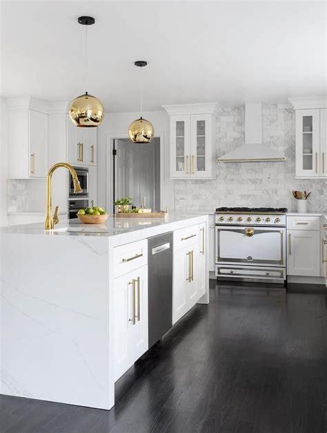 stunning kitchen featuring  white quartz waterfall island