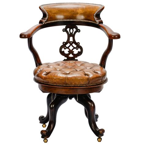 mahogany and tufted leather swivel desk chair at