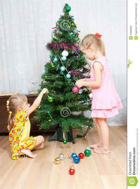 children decorate the christmas tree stock photo image