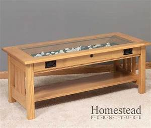 not this one exactly but one similar to it glass top With coffee table with storage and glass top