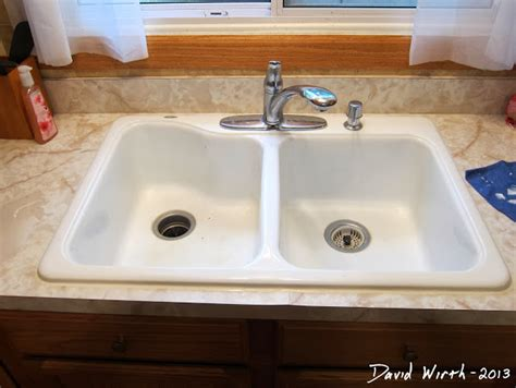 caulking around kitchen sink fix caulk around a sink 5143