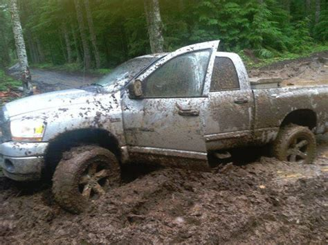 dodge mud truck dodge ram in the mud needs my ford f150 to pull it out
