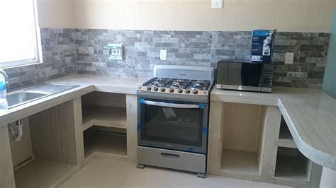 repara cocina en departamento  cubierta  muros de