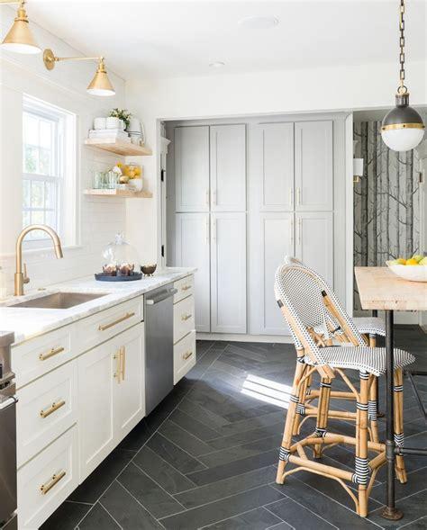 white grey brass kitchen  herringbone tile floor