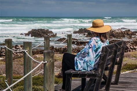 photo woman sitting seaside rocks  image