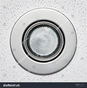 Closeup of pot light recessed lighting in ceiling tile