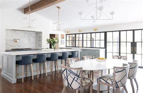 dark blue leather chairs  long light gray kitchen island