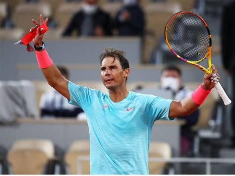 Record-chasing Nadal eases into French Open second round ...