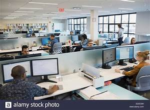 Business people working in open office Stock Photo ...