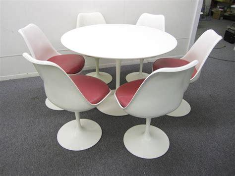 set of six knoll saarinen swivel tulip chairs and laminate