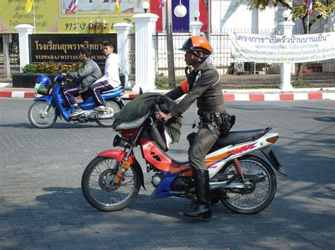 Th Police With (not Police) Motorcycle.jpg